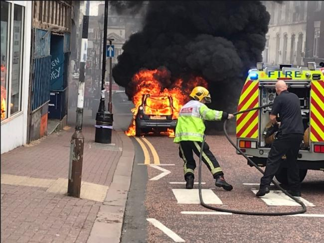 The car fire happened at the top of Dudley high street this afternoon. Photo: Tina Higgins.