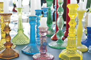 So pretty: A collection of coloured glass candlesticks is a cheerful sight.