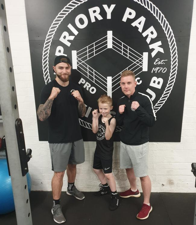 Tobias Totney, centre, with Dale Flute and Thomas Stanford at Priory Park Boxing Club.