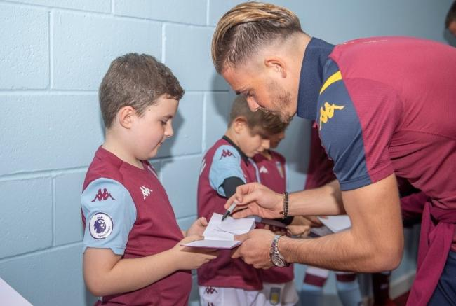 Finley Hill with his favourite player, Aston Villa captain Jack Grealish.
