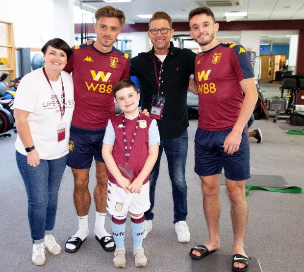 Bromsgrove Advertiser: Finley Hill and parents Jo and Paul with Aston Villa stars Jack Grealish and John McGinn.