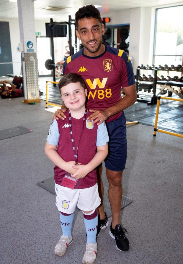 Bromsgrove Advertiser: Finley Hill and Aston Villa full-back Neil Taylor.