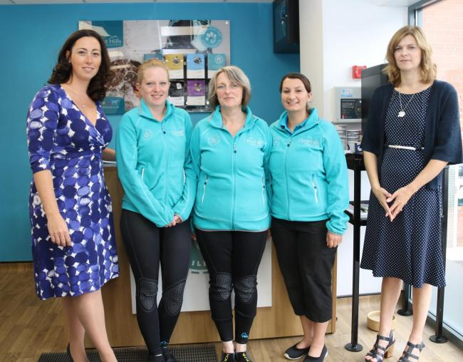 Rebekka Fiorani (left) with marketing manager Amy Holloway (right) and therapists at the Pet Fitness & Rehab Centre