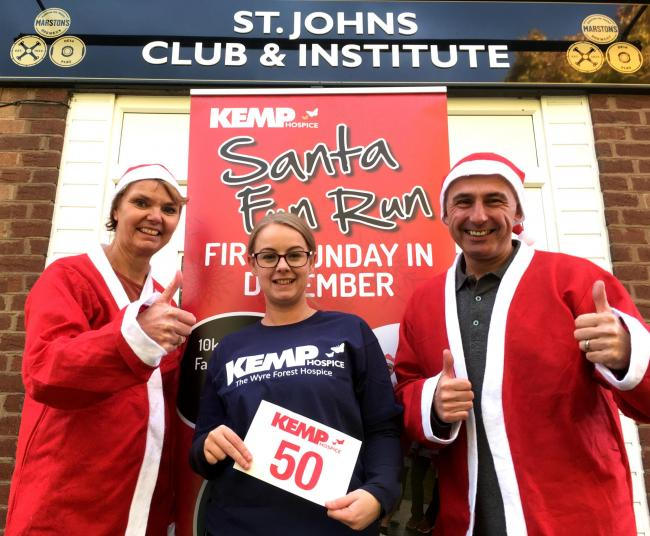 Ruth Mayall and Shaun Marshall, from St John's Social Club, dressed as Santas, with KEMP Hospice event fundraiser Shelley Stanley