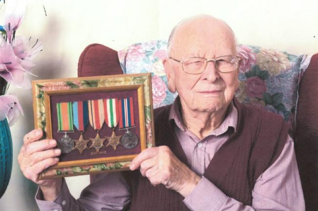 The late Arthur Grisbrook with his war medals that have now been stolen