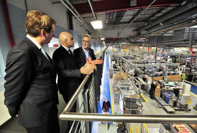 Chancellor of the Exchequer Sajid Javid (centre) with Robin Walker and Bosch CEO Carl Arntzen during a visit to Worcester Bosch. Photo: Jonathan Barry