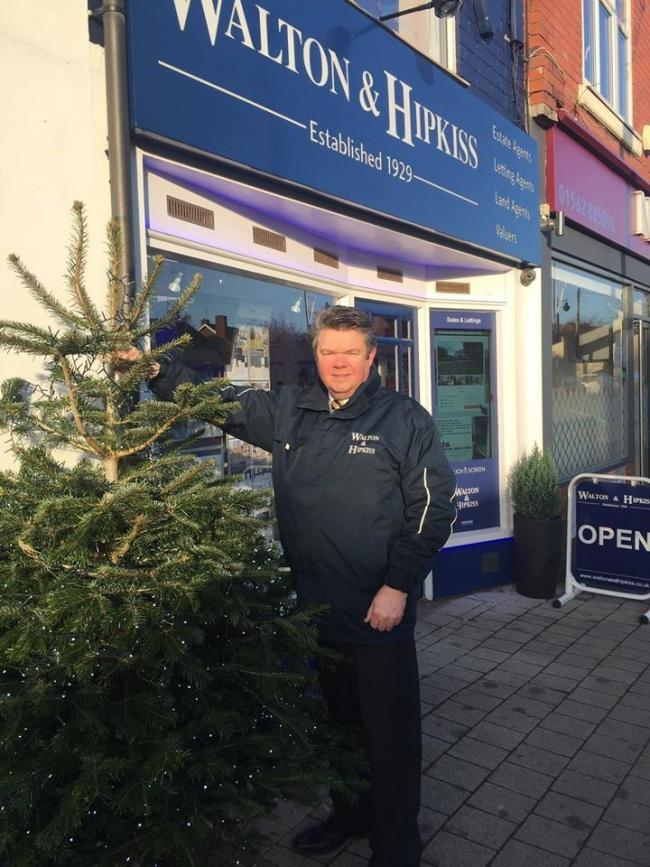 Andrew Hipkiss and the tree outside Walton and Hipkiss in Hagley