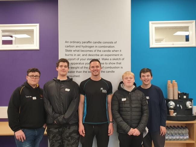 The four North Bromsgrove High School pupils selected for the AQA Unlocking Potential programme, alongside former world BMX champion and mentor Kelvin Batey (centre).