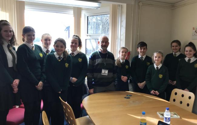 Ten Catshill Middle School pupils had lunch with Holocaust survivor John Fieldsend after he gave a talk at the school.