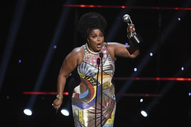 Lizzo wins the award for entertainer of the year at the 51st NAACP Image Awards