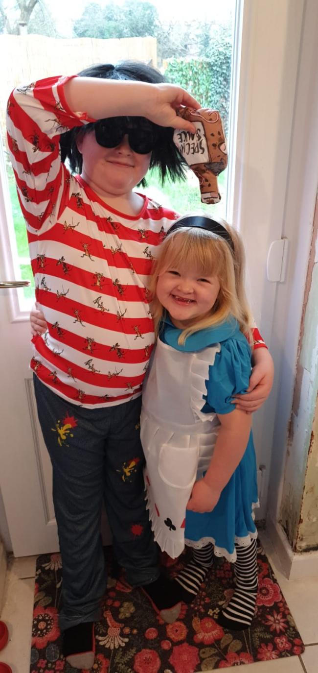 Alice in wonderland aka Louisa Collins meets rat burger aka Riley Collins for world book day.
