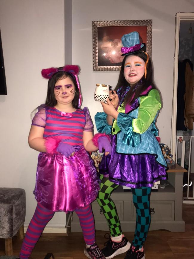 My girls  Mia age 7 cheshire cat Maisie age 9 the mad hatter