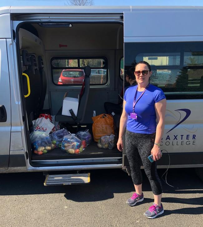 Baxter College assistant principal Katie Beech loads the minibus with food hampers
