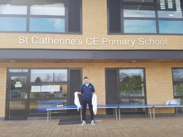 Bromsgrove Advertiser: Dave Mottershead, of St Catherine's Primary School, receiving a donation of wash bags