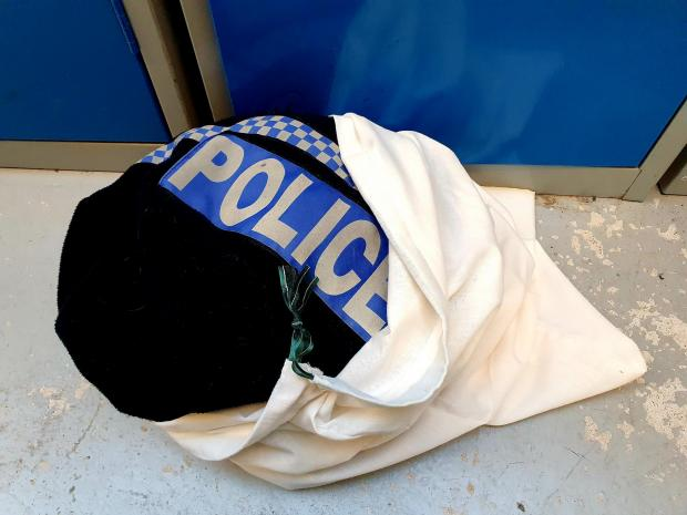 Bromsgrove Advertiser: A police uniform in one of the pillowcase wash bags