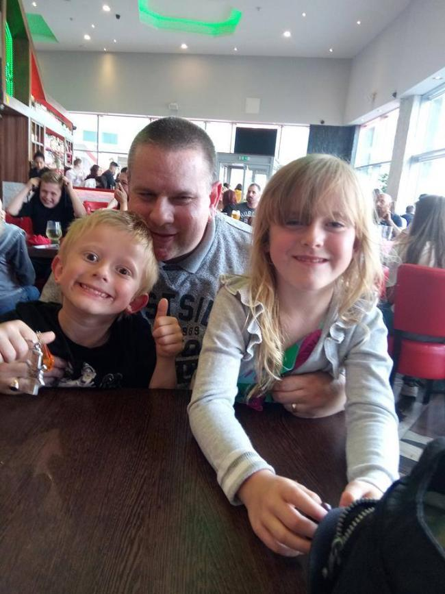 My husband Scott Lycett. Bus driver for Diamond. Photographs of him with our twins Kara and Sam. We absolutely adore him and always try to make the most of his days off. The shifts are long and tiring and we're always glad when he's finally home.