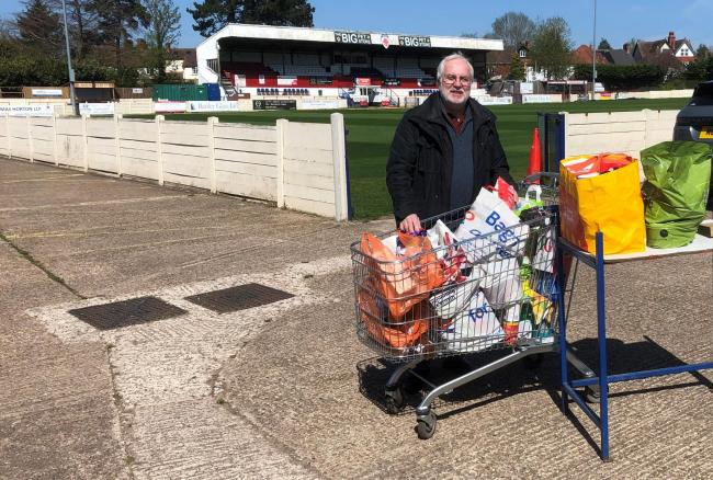 Club chairman Mike Burke with some of the items donated.