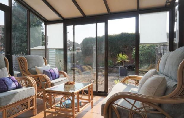 Bromsgrove Advertiser: A conservatory in the property (Photo: Rightmove)