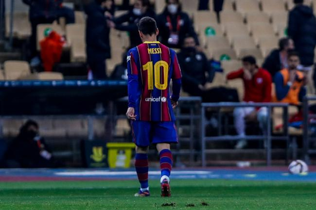 Lionel Messi leaves the field after being sent off