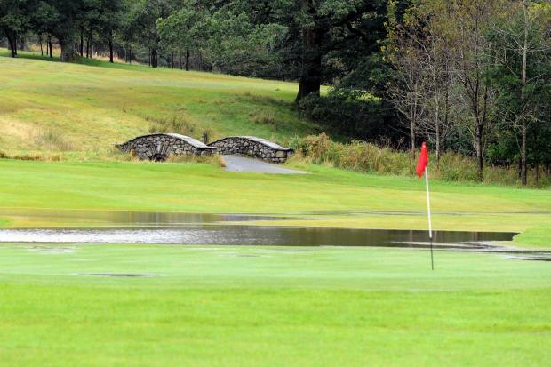 WATERING THE GREEN: puddles on the 18th green at Keswick Golf Club after torrential overnight rains caused the nearby beck to overflow; Tuesday 25th September 2012: PAUL JOHNSON 50038942T004.JPG