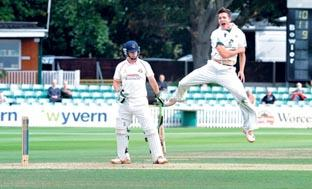 JUMPING FOR JOY: Worcestershire pace bowler Richard Jones celebrates the wicket of Steven Croft at New Road.