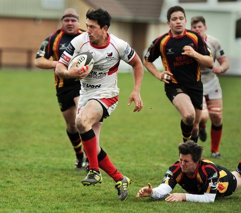 Break: Bromsgrove's Warren Oliver goes on a run against Hull. Picture: PETE JEPSON.