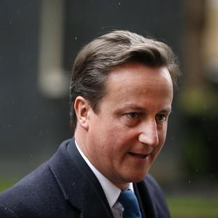 David Cameron expressed disappointment with the recession but insisted the Coalition will stick to its austerity plan (AP)