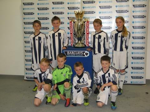 Trophy dream: Aston Field Middle School's year six football team with the Premier League Trophy.