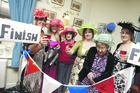Staff and residents from Regents Court Care Home enjoyed a glamorous Ascot themed day. Buy this photo: BCR271202_a