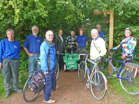 Cyclists and British Waterways volunteers with Andrew Cartwright, Waitrose branch manager, testing a newly widened towpath entrance.