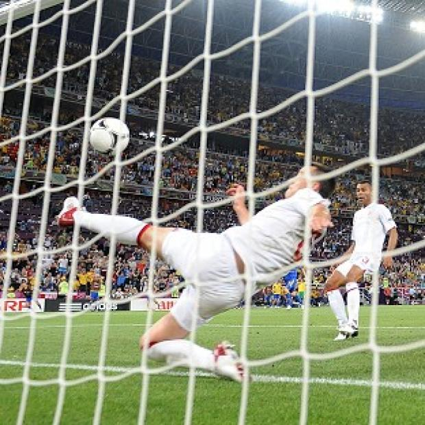 England's John Terry clears the ball from behind the line against Ukraine