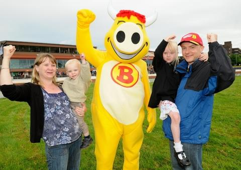 "Moo-ving mascot: Keith Rogers and family see his design for ""Brummie the Friendly Bull"" come to life."