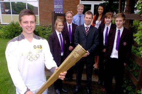 Glenn Scott, nominated by Redditch Council, to carry the Olympic torch, with Kingsley College assistant headteacher Andy Wakefield and pupils