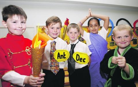 Super ceremony: Charford First School pupils James Jones, Henry Burton, Henry Smith, Selina Sangheri, and Jacob Pitt, all aged seven, who took part in their own opening ceremony. Buy this photo BCR271201_a