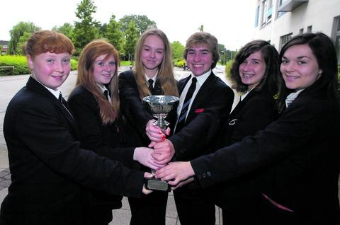 South Bromsgrove High School pupils Hannah Collett, 14, Leyna May, 13, Leah Norton, 14, Alex Brooks, 14, Sian Griffiths, 14, and Lucy Kilgallen, 14, who won the poetry slam competition. Buy photo BMM301201a