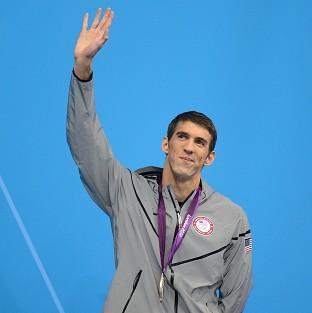 Michael Phelps with his record-equalling silver medal