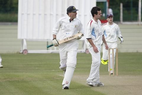 Chase is on: Droitwich's Jerome Connor goes for runs.