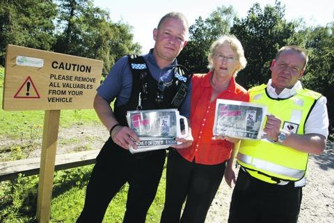 Vehicle crime: Community Support Officer David Anderson, Councillor Margaret Sherrey and Neil Reid, community enforcement officer, at the launch of the campaign against beauty spot crime. Buy photo BCR381203_a
