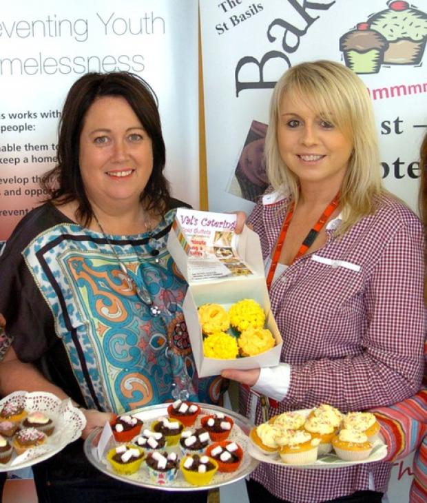 Bake off: Chris Cerrone, from Absolute Housing director, with Leigh Hesketh, service co-ordinator at St Basils, at the bake off event raising money for the charity. Buy this photo DSC_0931