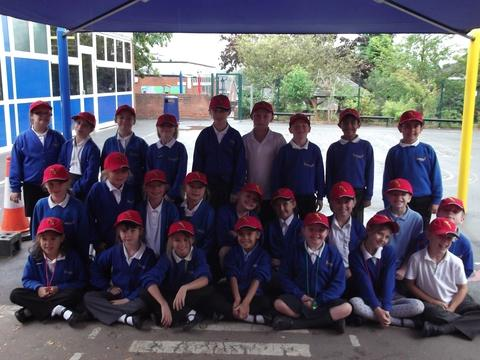 Taking the lead: The play leaders, in their red caps, at Millfields First School. Ref:s
