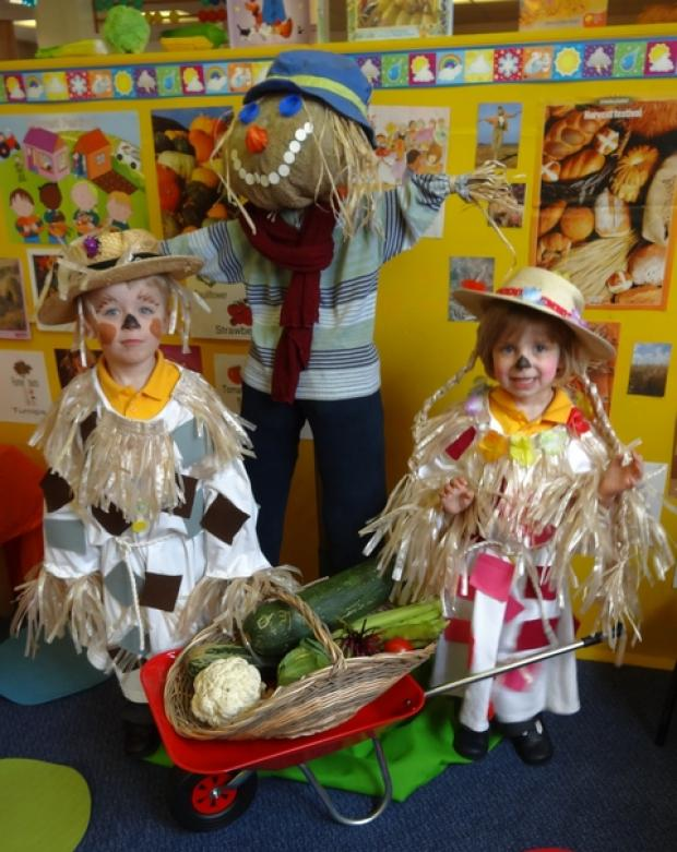 Harvest celebrating: Gabriel and Mia Beeton, both aged three, at Abacus Nursery's harvest celebrations. Ref:s