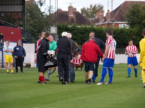 Injury agony: Luke Dugmore is carried off after breaking his leg in Saturday's draw with Boleshall Swifts. Picture: ANDRE ROBERTS