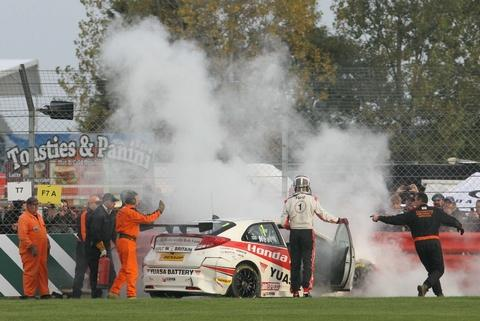 Up in smoke: Matt Neil's Honda on fire. Picture: DARREN PRICE