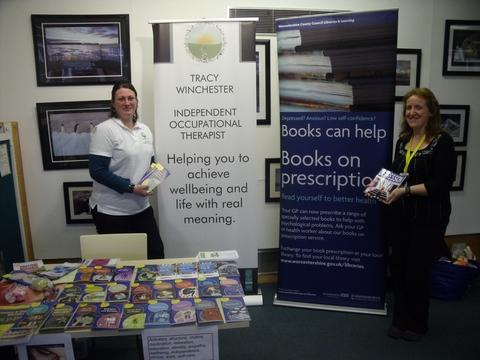 Tracy Winchester, occupational therapist and Abi Williams, Bromsgrove Library manager, with a range of leaflets on mental health.