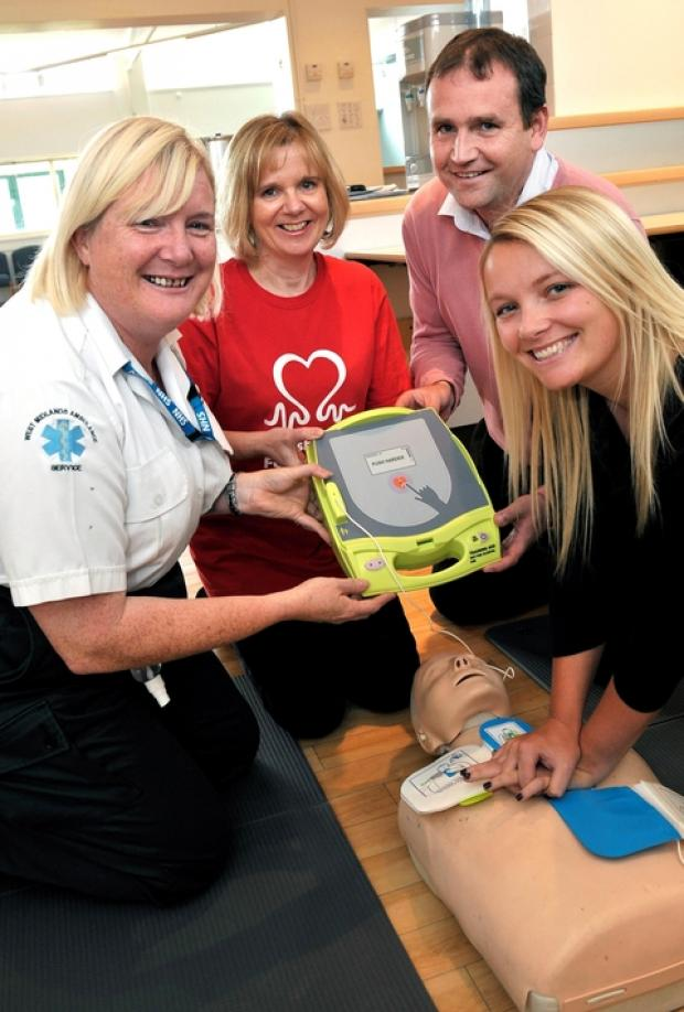 Life saving: Diane Pearson, community first response trainer, Donna Stokes from the British Heart Foundation, train Ryland Centre staff members Neil Duggan and Michelle Jones. Ref:s