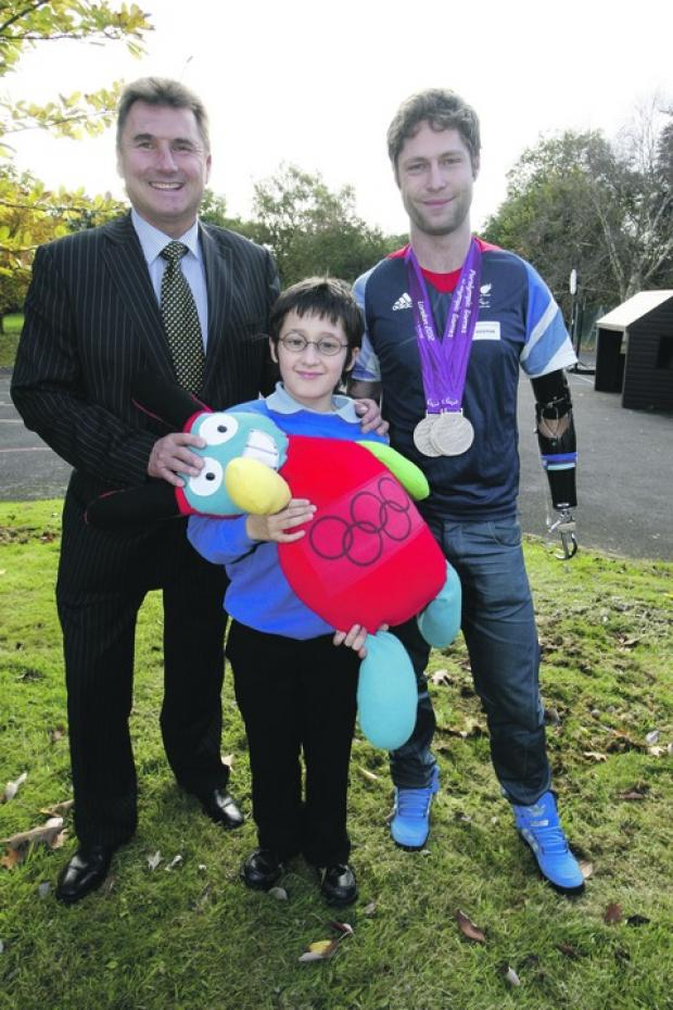 Lucky mascot: Jayson Yates, 11, with his real life toy mascot, pictured with Paralympian silver medalist Jon-Allan Butterworth, and Paul Massey, chief executive of AKW. Buy photo BCR441201a