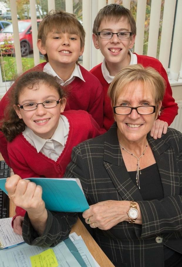 Good Ofsted: Rigby Hall School's headteacher Cynthia Pitts with pupils Mary Tait, Elliot Lee and Charley Wooley, with a copy of the school's good Ofsted report.
