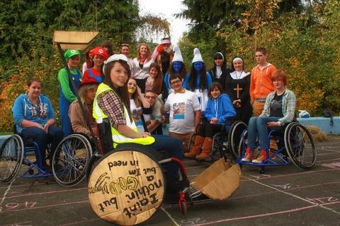 Support for student: Lauren Rowles with fellow pupils at a recent North Bromsgrove High School fund-raiser for her. Ref:s