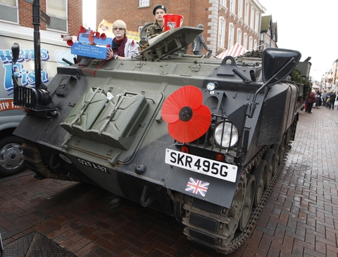 Special stall: Laura Hewitt, 15, and Josh Henning, 14, sitting in a tank, one of the military vehicles they formed part of the Royal British Legion's stall in Bromsgrove High Street.