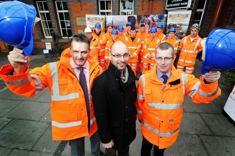 At their station: Nick Ralls, centre front, flanked by Gary Hardaker, left, managing director, Vital Rail and Lawrence Dobie, with the apprentices behind them.